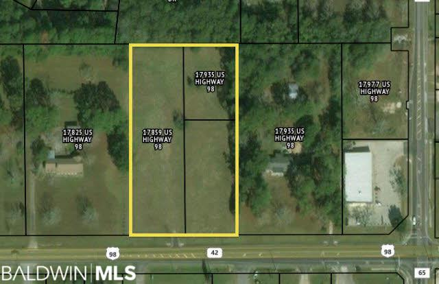 Two parcels that front Highway 98 with one that sits behind. All three parcels sold together. High traffic location, close to downtown Foley and blocks from the Foley Elementary school, all utilities available. Unzoned. Great location for various commercial uses.