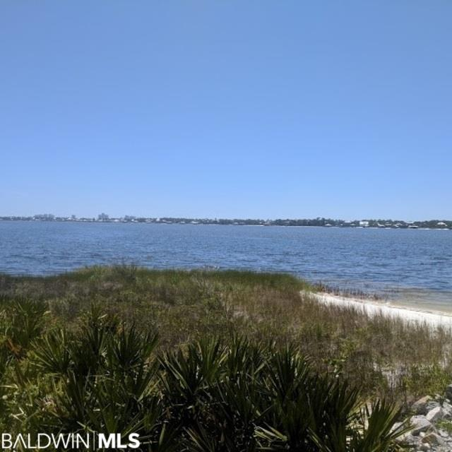 Large Waterfront Lot in Gated Community in Russell Bayou on Innerarity Island. Lot is dry with no Wetland Issues and gives you a Large Building Footprint. Lot offer around 80' on the Intercoastal Waterway with a Sandy Beach. Russell Bayou offers Nature Trails, Tennis Courts, and Swimming Pool. Don't miss your chance at one the Islands Best Buildable Lots!