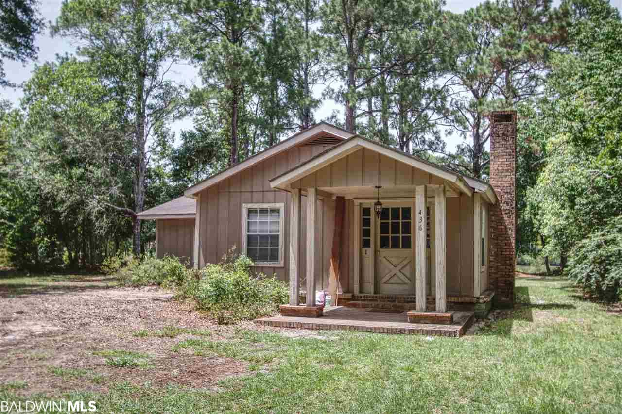 100 Feet of Shoreline on the Intracoastal Waterway!  This cabin on the water is conveniently located near everything you want in Gulf Shores.  Within walking distance, you will find the Waterway District, (ACME Oyster House, Tacky Jacks and the local brewpub) and the city's sport complex.  Convenient for getting around the local traffic, this location is perfect for boating or boat watching.  From the boat, you can get to the Wharf in 10 minutes, Pirate's Cove in 20 minutes and Perdido Bay in 25 minutes.  Build your boat house and live the life in Gulf Shores.  Location is everything, and this is near everything you love!