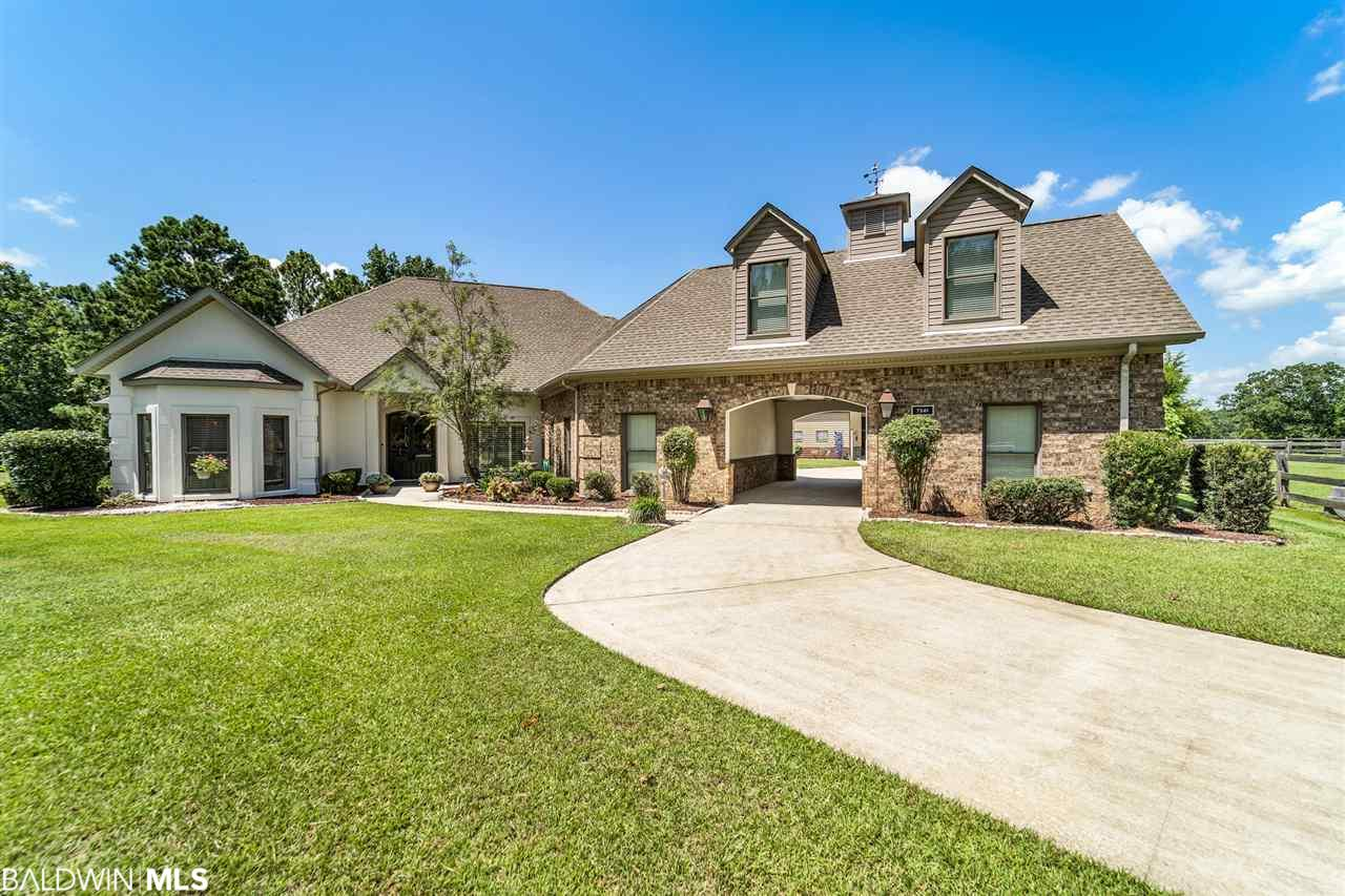 Located On What Was a Bivouac Camp From the Civil War, is a Unique Estate Within the Gated Equestrian Community of Blakeley Plantation. Custom Built with No Expense Spared, this Exquisite Property Features 6 Acres, 2 Separate Pastures(Currently with 3 horses) Fishing Pond & a 50x50 Barn that Includes a Heated and Cooled 11x50 Shop that Could Easily be Converted Into a Guest House. As You Enter Home, Gas Lanterns & Mahogany Doors Lead You Into the Foyer With Custom Tile Work. The Oversized Great Room has 10 Ft Trey Ceilings with Ambient Lighting, Crown Molding, a Stunning Fireplace & is Open to the Gourmet Kitchen, Breakfast Area & Dining Room. The Bright & Airy Kitchen Features Custom Cabinets with Built in Stemware Storage, Granite Counter