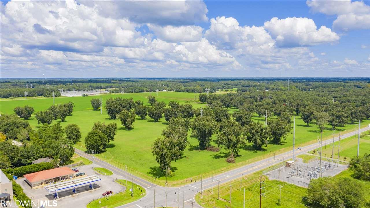 This property has a lot of potential! On the corner of County Road 49 and Highway 104, this 18+ acre parcel is in an UNZONED area of Baldwin County. It could be developed in multiple different ways, the sky's the limit!   There is 635.21' of frontage on Highway 104, and 1286.89' of frontage on County Road 49.  Please see the survey in Documents. This listing is for LOT 1.