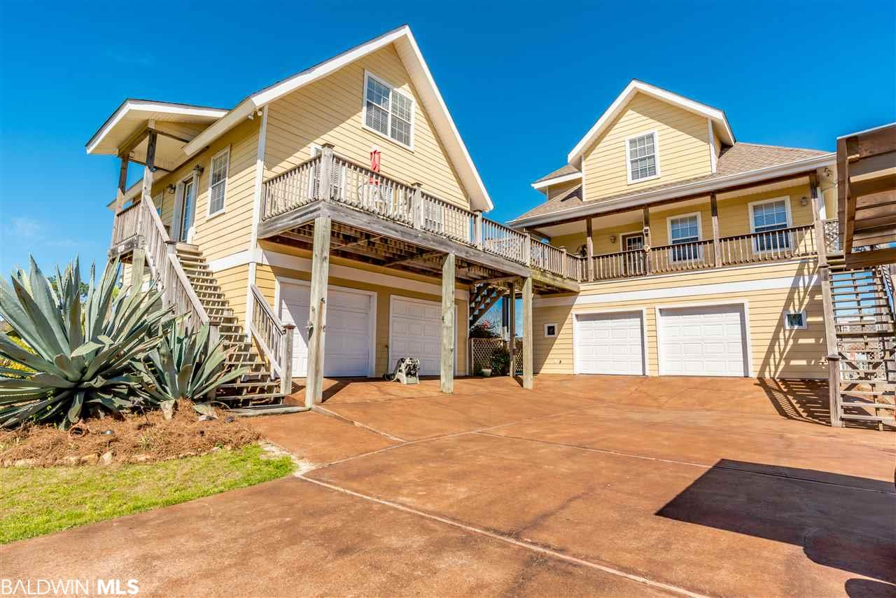This is one of the most unique properties in Orange Beach! Two separate homes on one property, something that will never be duplicated with the current building restrictions. The current owners used to reside in one home and rent the other as a vacation rental.   The main home has a full kitchen just off the pool area. The ground floor also has a den, party room with french doors leading outside and a full bath, as well as a Mancave/rod & reel room which is heated and cooled. There is also a two car garage.  On the second floor you will find a bedroom with an attached bath and a walk-in closet, Living room, another full bath, kitchen, laundry, and sunroom.  On the third floor you will find the Master suite with a balcony overlooking the can