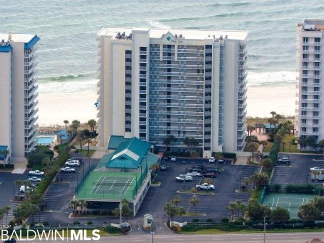 Don't miss this beautifully updated unit in one of the most centrally located buildings in Orange Beach!  This unit is situated in the perfect spot overlooking the pool, and the view of the Gulf of Mexico from the private balcony is breathtaking!  No need to take the elevator if you don't want to wait since this unit is located on the third floor.  With high end cabinets, granite countertops, stainless appliances and wood-look tile floors, this unit is move in ready--no to-do list!  Appliances, digital thermostat, and hot water heater are less than five years old.  An automatic Kaba lock makes entry to this unit a breeze, while two owner's closets with automatic locks offer additional storage.  Property amenities include outdoor pool and ki