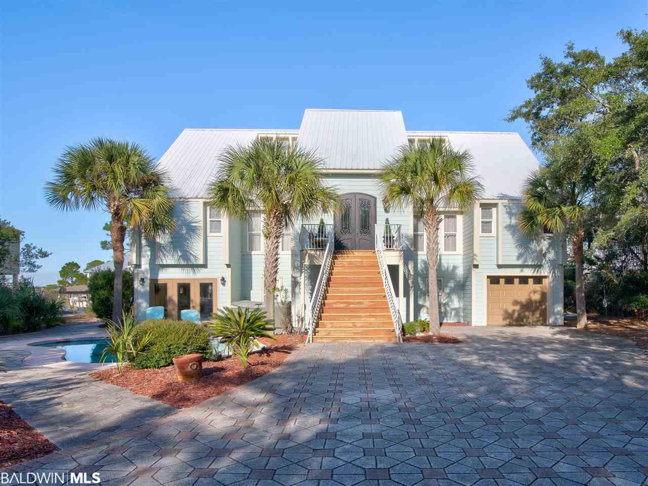 BOATERS DREAM! PROTECTED WATERFRONT, GORGEOUS BAY VIEW, POOL, ELEVATOR, Mother-In-Law Suite, 6+Bedrooms, Quiet Cul-de-sac, PROTECTED water w/Gulf access, ELEVATOR, Inground POOL, Hot Tub, 2 LIVING AREAS w/ 2 Kitchens.  PROFESSIONAL DREAM CHEF Kitchen with STAINLESS STEEL Professional Series Viking GAS Stove w/griddle, grill, 6 burners, 2 ovens, Miele coffee maker, Kitchen Maid cabinets, GRANITE,  French door refrig, Miele steamer. Thick Brazilian Cherry Flooring. 950 lb Capacity Maple Elevator, SOARING VAULTED CEILINGS, Beautifully Redecorated & approx $40k in upgrades. Upscale neutral decor offer elegance & tranquility. Main floor Master Suite, Living Rm, DECK overlook Canal & Bay. Formal Dining Rm, Sitting Rm. 1,000sf ground-floor bonus a