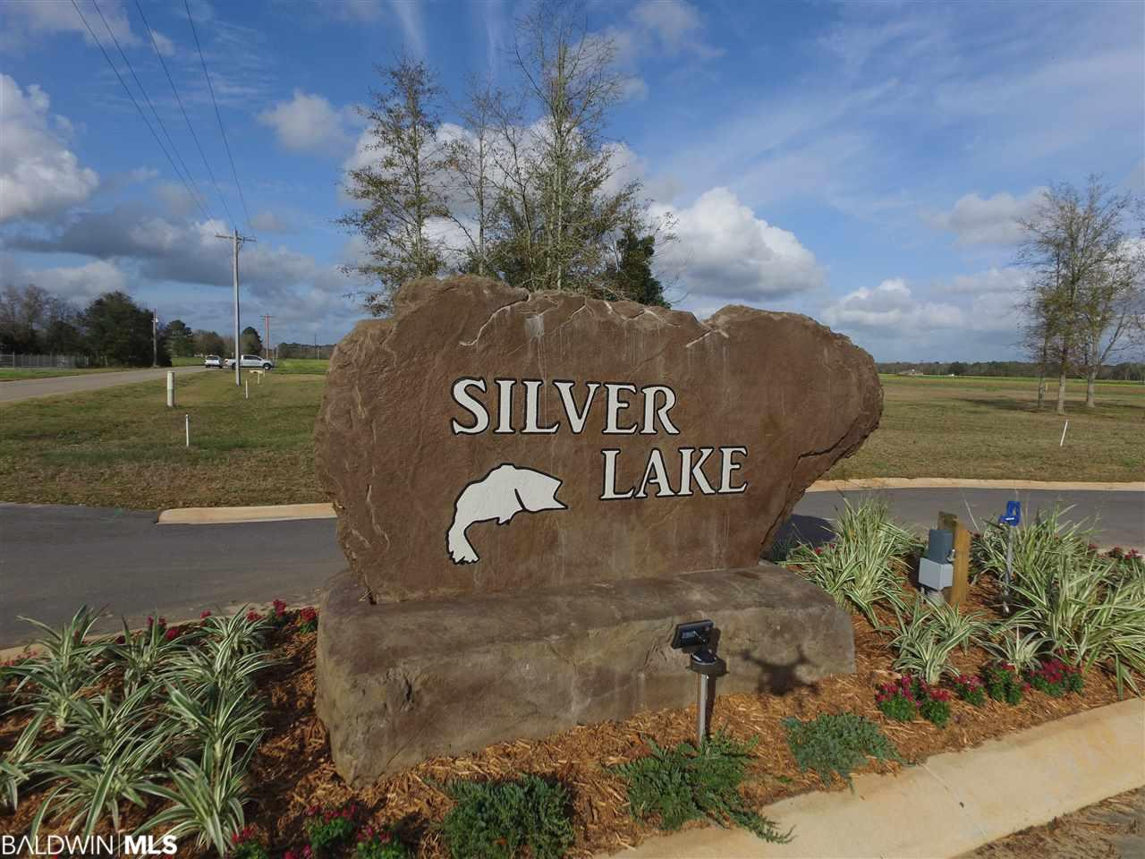 Enjoy tranquil living on estate size lots in this new subdivision just south of Silverhill.  This beautiful lot is the largest in the of bunch and directly on the lakefront.  You'll love the fishing or just admiring the view. Come home to Silver Lake where you'll love the peaceful and quiet enjoyment of this rural community. Perfectly located in Central Southern Baldwin County and less than ten minutes from 1-10, Fairhope, The Beach Express, Robertsdale and Foley. Choose your own builder and begin living the good life you deserve in Silver Lake!