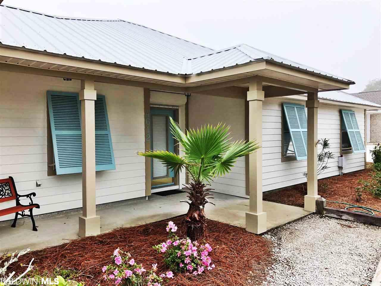 Very cute clean house on Ono Island! New paint inside and out including garage floor, new vinyl floors in bedrooms, cabinets redone, popcorn ceiling removed, some new lighting. Must see!