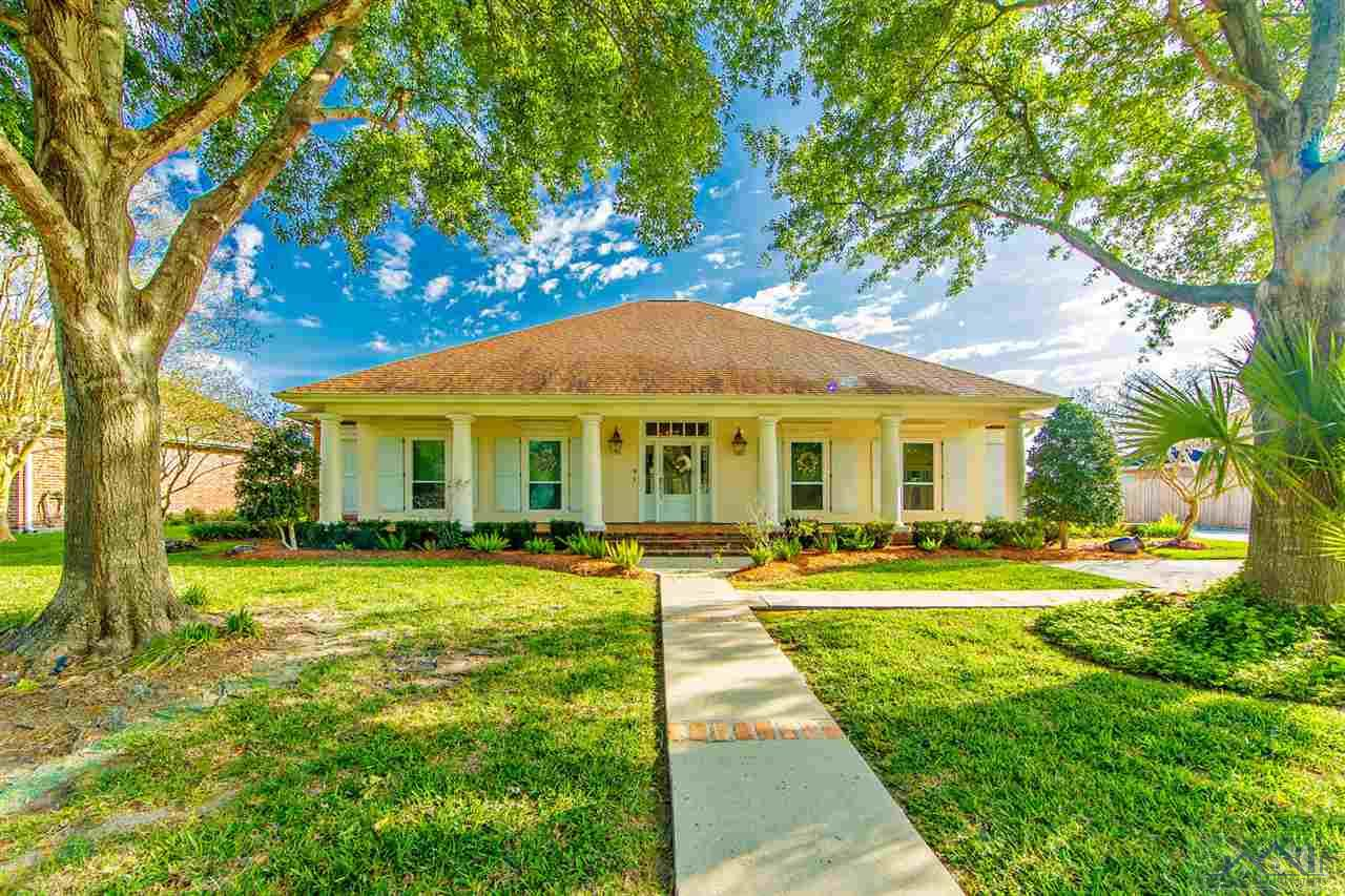 REDUCED BELOW APPRAISAL AND FRESHLY PAINTED EXTERIOR IN DESIGNER TONES to make your purchasing decision easier!  Serene Luxury with an envious locale for a fabulous price!  A chef friendly high-end kitchen remodel is one of the many amenities featured in this perfect chateau.  The open formal living and dining areas are made for entertaining any size crowd that suits your needs.  Featuring an expansive sunroom which looks out onto the perfectly manicured grounds, pool and shaded patio area.  Perfect spacing and floor layout make this economically friendly home a must see for any growing millennial family, or downsizing for those who want less upkeep.  OPTION OF LEASE/PURCHASE