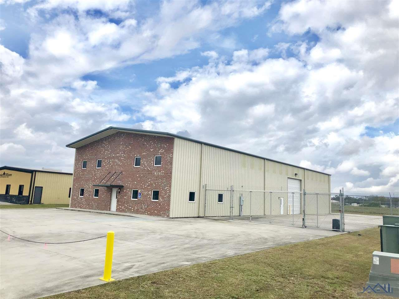 GREAT Commercial / Industrial Building in a GREAT location!! Well maintained, very close to HWY 90. This building was designed for up to a 5 ton overhead Crane.  High elevations, nice fenced in loading area with electric slide Gate and very functional office space and warehouse. Building has a loft with 1,500 sq. ft. unfinished office/storage space. This is a TRIPLE NET LEASE (Tenant is responsible for utilities, maintenance, taxes and Insurance).