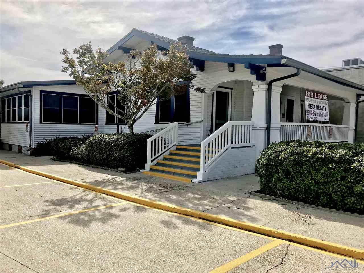 Ideal Location for any type of Business! Located in the Heart of Downtown Houma with access to Legal Offices, Medical practices, Hospitals, City & District Courts, Retail Shops, Government Towers, Churches, Schools and Restaurants. This building was previously a Medical Practice and has a large Reception/Waiting area, Large Secretarial area, 7 offices, 3 Bathrooms, Kitchen area and is ADA compliant.  Enjoy the original wood floors, High ceilings, 2 Fireplaces, nice wood walls in most areas and a Beautiful Front Porch. 1 room was a former surgical room with FRP (Fiberglass Reinforced Plastic) walls . There are approximately 14 paved parking spaces (2 covered) with a detached Storage area. This is a Triple Net Lease. The Owner is willing to pay up to $10,000.00 for Tenant improvements for those who qualify.