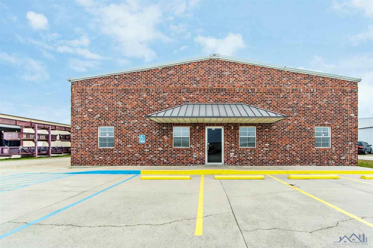 First Class Building Located in Houma's PRIME Industrial/Commercial Park. This property suits all of your Business needs with 12,500 sf. of heated and cooled space (5) 20 ton units. The office space is 1,910 sf. with 4 nice size offices, Large entry area, Full kitchen, Conference room, 2 restrooms and a large tool room. The Warehouse is 10,590 sf. which is also climate controlled with 4 large overhead doors (14' x 14'), 2 JIB cranes and an a air compressor. There is plenty parking and concrete surrounding the building. Easy access to Interstate/Highway 90. First year's rent is $7,500 per month with accelerating rents over the following years. Insurance is $5,144.00 per year. All information must be verified.  Property also available for Sale.   Please call listing agent for showings.