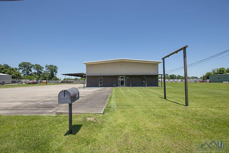 Office/Warehouse with MANY opportunites!! This property has 2,500 sq. ft. of office space (7 offices, kitchen/breakroom, IT/Computer room, large lobby and reception area and 1 restroom in office area). 2,500 sq. ft. warehouse with overhead door as well as a loft and 1 restroom in warehouse. Room to grow with PLENTY of yard space with large covered areas on the side and rear of building.Call listing agent for showings.