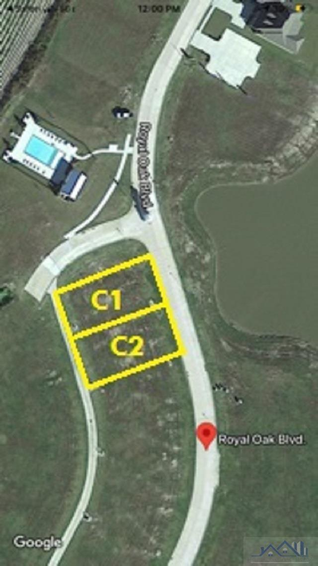 """Located in The Settlement at Live Oaks this """"READY TO BUILD"""" Cottage lot includes lake views, and adjacent park. Created by the developers of River Ranch. A master plan designed with a mix of retail, dining, & professional services. Touting """"A true walkable community with a return to the traditional concept of Main Street in America""""  in mind.   The Settlement at Live Oaks was built on Live Oak Plantation, preserving the historic Live Oak trees that have become iconic to our South roots, creating a backdrop for the extensive landscape & architectural design of this community."""