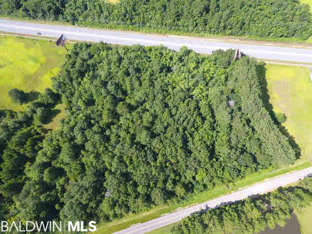 Perfectly located Commercial Acreage on Highway 59! With 550 feet of road frontage, this heavily wooded lot is situated in one of Loxley's more teeming retail areas, giving it a major advantage in terms of traffic. Plus, the lot connects to both Hwy 59 and Black Devine Road, sitting only 2 miles from Interstate! Property has income-producing Billboard Lease that can convey with acceptable offer. Already set up for city water/sewage, this land lacks only one thing: a developer with the vision to bring out its FULL POTENTIAL! Whether you are an investor or developer, you will not want to miss this amazing opportunity! Call TODAY!