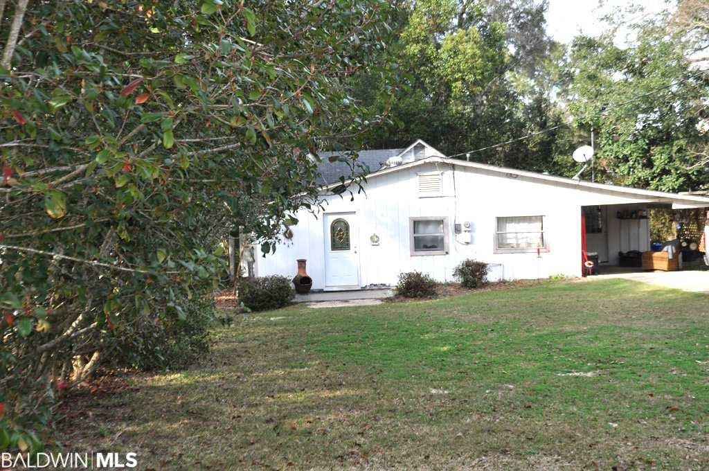 "Located In ""The Bluff"" Area Of Old Fairhope One Lot East Of North Bayview Street And Public Park Areas Overlooking Mobile Bay / Bay Access VIA Steps From Park To Beach And Situated In Close Proximity To Downtown / 1950's Cottage To Be Conveyed In ""As Is"" Condition / Currently Occupied On A Month To Month Basis By Tenant Interested In Establishing A One Year Lease @ $1,200.00 Per Month Subject To Buyer's Interest - Approval / Primary Value Is Related To The Site With Minimal Value Attributed To Improvements / Views Of Bay From Front Yard / Land Area Approximately .25 Of An Acre."