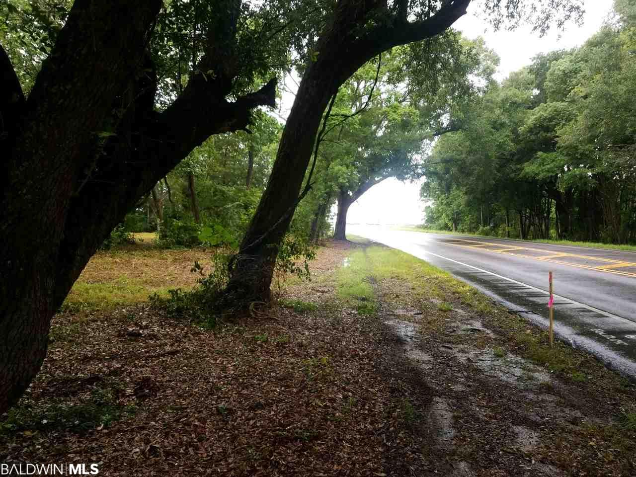 Wooded lot, 3.15 acres (approximate) located on W Hwy 90 intersecting with 4280 Magnolia Street. Walking distance to Loxley Municipal Park. Only a 2 minute drive off of Interstate 10.    Zoning B-1