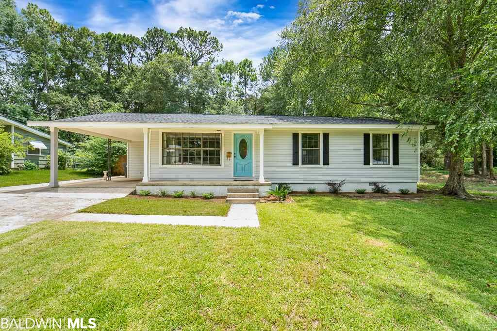 This spacious Downtown Fairhope ranch style home has over 2200 sq ft of living space!  Beautiful and move in ready, this home is within walking distance to downtown shops, restaurants and activities.!  The majority of the home was tastefully remodeled in 2015 and features: new paint, new tile and luxury vinyl plank flooring throughout (no carpet), SS appliances, Fantasy Brown marble counter tops in the kitchen and all new lighting.  A bronze certified new roof was installed earlier this year.  This gorgeous home offers a split floor plan, open concept living and a large heated and cooled sun room that could be used as an office, play area or additional entertaining space.  Outside you will find a fenced back yard with a concrete slab for your future tool shed or shop and in the front yard you'll enjoy picking fresh fruit from your very own grapefruit and satsuma trees.  Make your appointment today to see this beautiful home, it won't last long!