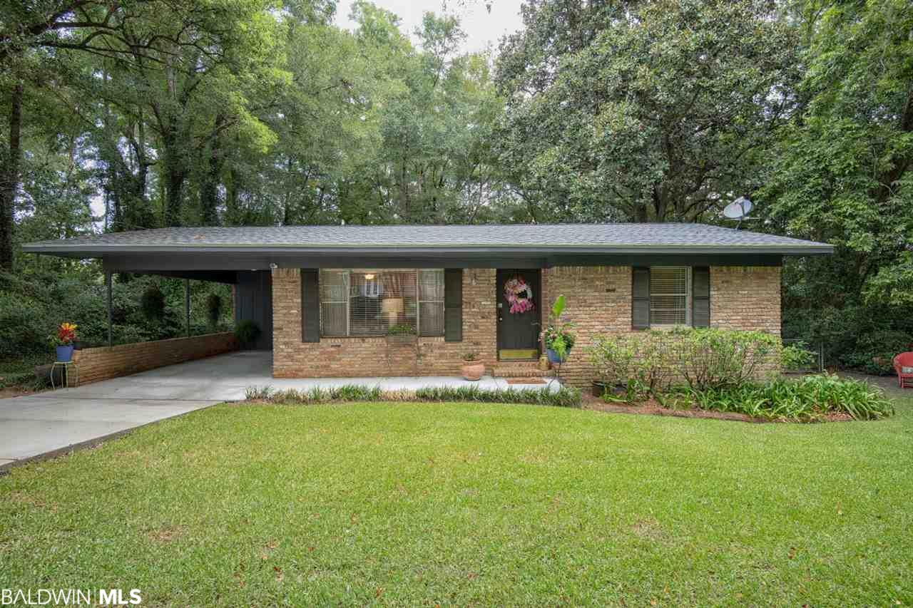 Outstanding Fairhope cottage in a premier location within walking distance of Downtown that sits on an EXTRA LARGE LOT (118x158) on a private, cul-de-sac street. This adorable home offers two spacious bedrooms, updated bathroom, wood flooring throughout, large living/dining area w/ picture window, and a separate den! Perfect home for first time homebuyers, retirement, or investment! Schedule your showing today. Home Warranty Included in Purchase!