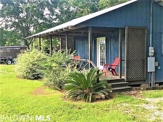 Perfect Quaint Location for your next Business. With complete Hwy 59 Road frontage, the visibility is like no other. This 1 acre listing has a cute office space available as well. There are endless business opportunities with this location! LEASE PURCHASE OPTION AVAILABLE.