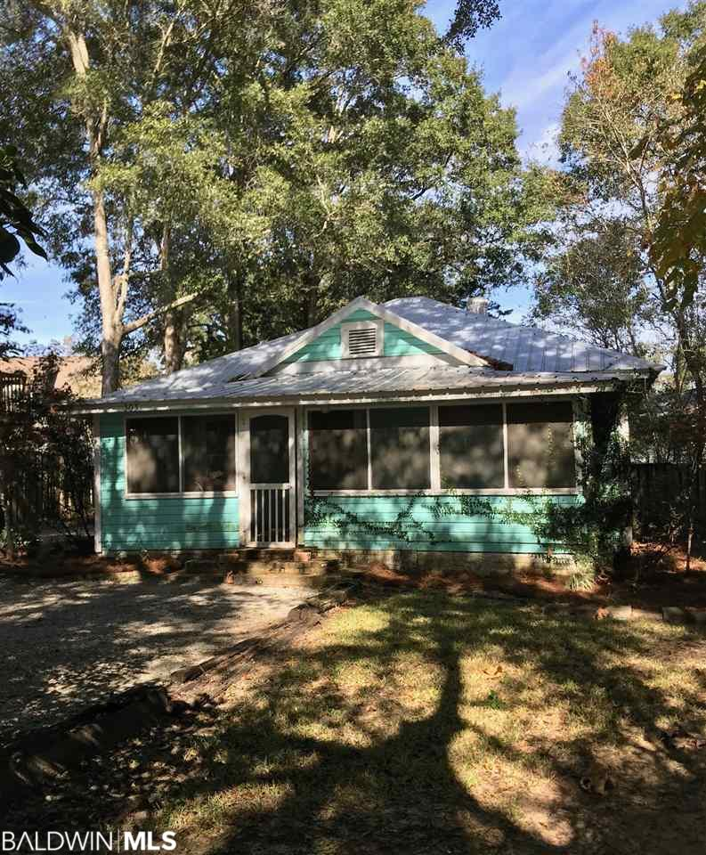 Lovely old Fairhope cottage within three blocks to downtown.  Bamboo flooring in the main areas, tile in the bath and carpet in the bedrooms.  But, that porch!  That incredible screened porch spanning the house front - perfect for dreaming an afternoon away, or whatever your heart desires.  Tankless hot water heater, metal roof and a fenced back yard.  This is the place where your dreams do come true.