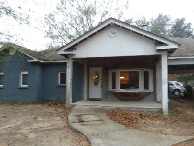 Great location, 3/2 cottage on an acre of land with six (6) large storage buildings, (2) RV hook ups - water & electric.  Home is on well and septic, front porch -24x28.  Tile and concrete flooring in 2 bedrooms,  block and stucco.  Most of the materials are included to finish inside and outside of home, i.e. doors, trim and outside paint.