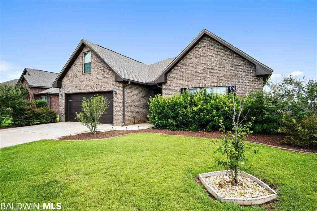 Look no further than this beautiful brick home in sought after Oldfield. This 3/2 with over 2100sf has so much to offer with its split and open floor plan, spacious kitchen with granite and a breakfast area and living room which overlook the large backyard and future landscaped pond. The home also features a large master suite and bath, as well as a bonus room and lovely screened in porch - perfect for that morning coffee or afternoon lemonade! Neighborhood amenities include a gorgeous pool! Great location with easy access to Fairhope, I10, shopping, schools and restaurants.