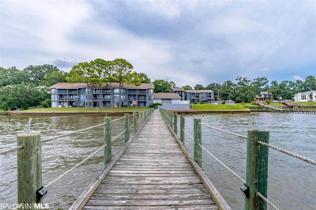 Enjoyed amazing panoramic views of Mobile Bay from your living room.  This one bedroom unit lives very large. Newly renovated with new kitchen and floor to ceiling windows in the Great room that also open to a spacious balcony with obscured views of Mobile Bay. Enjoy your private wharf and pool. Reserved parking and walking path to the Fairhope pier as well as down town shops and restaurants. Bay Winds Condos are an amazing value for everything you get for the price; bay front, assigned parking with plenty of guest parking, private pool, walking distance to town, restaurants, shopping, parks and grand hotel