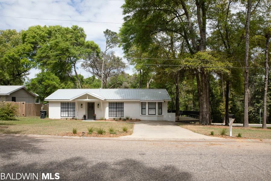 PRICED BELOW APPRAISAL - instant equity! Cute from the outside but you MUST see the inside to appreciate - WOW! This fantastic remodel near downtown Fairhope & deeded bay access checks ALL the boxes! Adorable inside & out on a flat corner lot - check. Walk to deeded bay access - check. Brand new roof, updated electrical/plumbing & new tankless water heater - check. New flooring, paint, master bathroom & deck - check. New exterior painted brick, wraparound deck with seating, decorator finishes throughout and fantastic views of the fabulous new Van Antwerp Park neighborhood - CHECK! This house is ready for you to move right in - don't miss it!