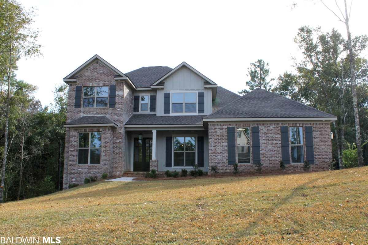 Welcome to the Manchester Plan by Truland Homes. This 5 bedroom, 3 bath home has over 3,300 square feet and sits on almost an acre lot and is full of custom features at every turn. Rich hardwood floors welcome you in and continue throughout the main floor. The large family room has a gas log fireplace with painted brick surround, shiplap and custom painted built-ins. The kitchen has painted wood cabinets and gorgeous granite, upgraded stainless appliances including a 6-burner gas cooktop and stainless steel apron sink. The master bedroom also has hardwood flooring, extra crown molding and recessed lighting. The master bath has a true spa-like feel with a free-standing soaking tub, painted cabinets with double vanities and lots of storage. The master shower has custom tile finishes including a mosaic tile floor.  There is one additional nice size bedroom and full bath on the main level. Travel upstairs using the beautiful wood stained stairs to find a hardwood floor landing with a desk and shelving area. The remaining three bedrooms and full bath are all located on the second level. This home is Gold Fortified for insurance savings, has energy efficient appliances and HVAC, double pane windows and extra insulation. One or more principles of the selling entity are licensed real estate agents/brokers in the State of Alabama.  Scheduled to be complete in November/December 2019, this home will have everything you need!