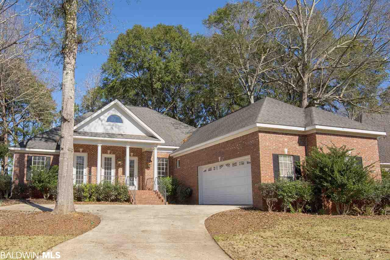 """This beautiful brick home on the golf course in Timbercreek has been freshly renovated to """"better than new"""" condition.  As you arrive you notice the classic look from the road with three 8' french doors off of the front porch.  As you enter the home, you're taken by the openness and warmth with tall ceilings, brand new hardwood floors, detailed moldings and banks of windows allowing natural light throughout.  The living room has beautiful custom built-in cabinets surrounding the brick, gas log fireplace.  The new kitchen is amazing with all brand new stainless appliances, double oven, gas range, granite counters and custom cabinets.    Enjoy the large master suite with pristine, new cabinets and fixtures in the master bath.  All of the baths have been completely renovated with new floors and fresh paint throughout the home.  Great views through the natural, fenced backyard to the immaculately maintained golf course from the living room, master or from the large, covered back porch.    Convenient to everything, great, established neighborhood, amazing view and privacy and the feel of a brand new, never lived in, house.  This is a fantastic deal.  Don't let this one slip by - call today for your tour."""
