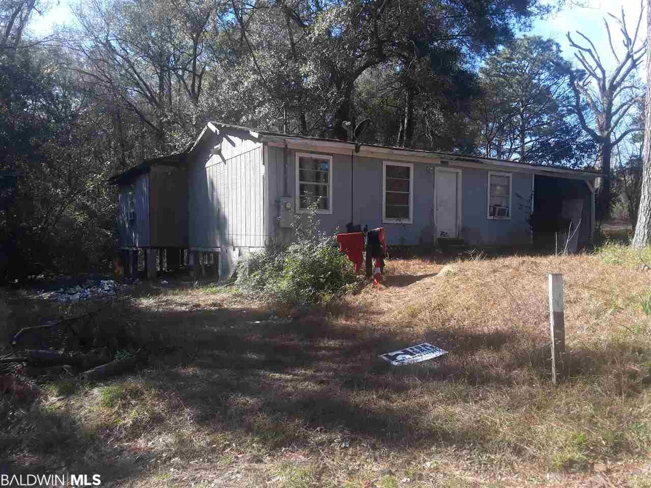 "An awesome opportunity to own a 3 bedroom 1 bath home with 896 sqft on 1 acre in Spanish Ft. This home does have a month to month renter in the property now at 900 a month. Has an old Mobile Home behind the home as well. Both the Home and the Mobile Home are to be Sold "" As Is Where Is "" and at no value. Price is for the land value only. Buy this home and fix it up to live in or as an investment opportunity. Knock it down and build something new. There is a approximately 15.4 acres adjacent to this property as well for 135,000. As well as another Home and 1.9 Acre for sale  at 55,000. You could buy roughly 20 acres, 2 homes and a Mobile Home in the heart of Spanish Ft for 235,000."
