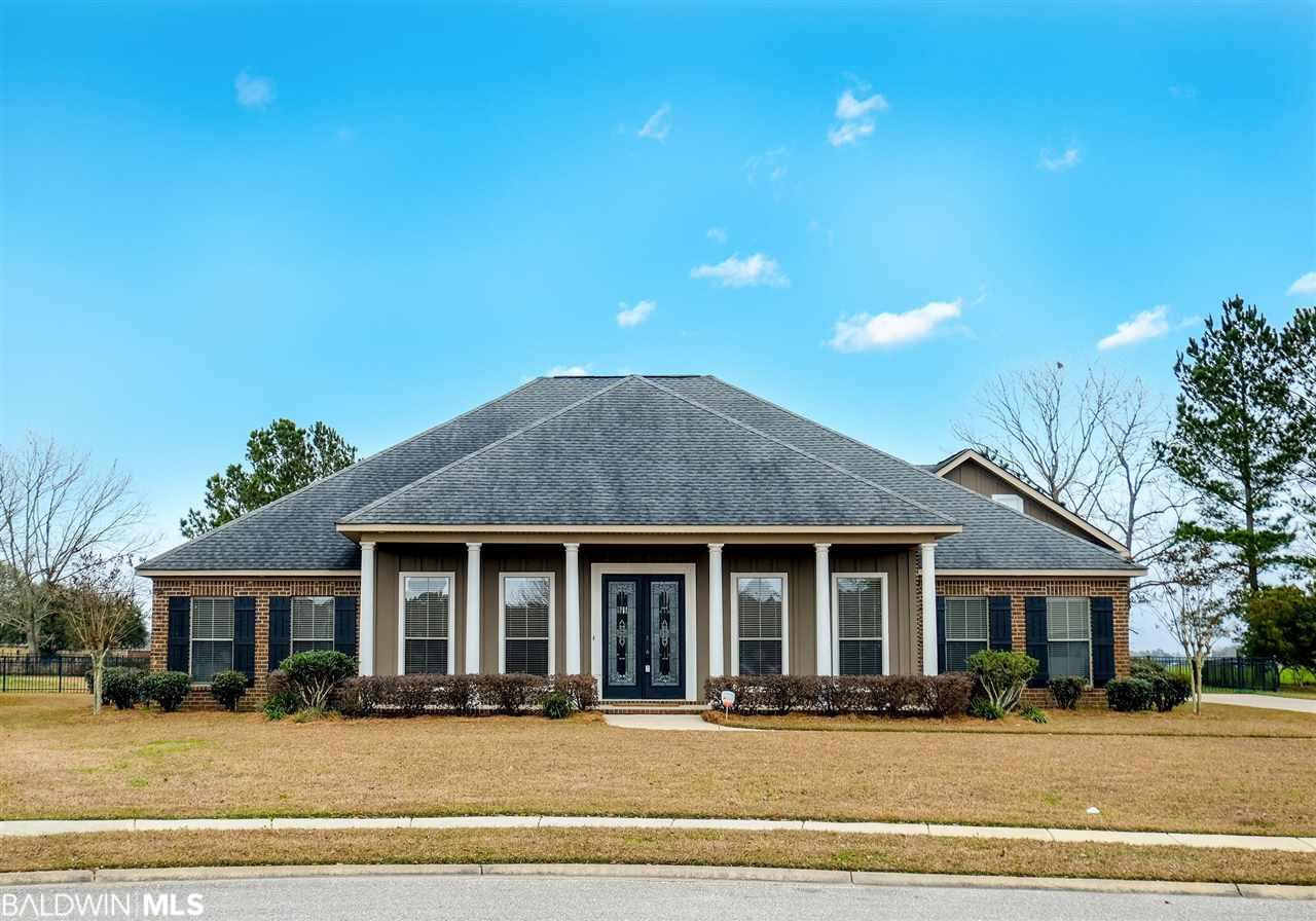 Great new price adjustment to $464,900, That is $129 per square foot, which is before market value on this estate home. Retain your value in this immaculate home built by custom builder, Ray Long. On a quiet street in a much sought-after neighborhood - totally upgraded & has tons of living space. 4 br, 3.5 ba, 3604 sq ft, formal dining room, office, breakfast room & closet for  appliances off kitchen, great room that is 21 x 27, split plan, 1.5 story with 15 x 32 bonus room & half bath over the garage is the only upstairs living space, 11 and 9 ceilings, blinds will convey, hardwood, tile, carpet flooring, 3 car garage (2 bay with 2 storage closed door areas & 1 bay), 3 air conditioning units, just under three-quarters of an acre, aluminum fenced yard allows you to see the lake, gourmet kitchen is huge with a 2.3 x 6.3 island, coffee bar, hop up bar with seating for 5 people, tons of cabinets, stainless steel appliance package with commercial grade 6 burner gas range, separate ice maker, stainless steel side by refrigerator with water & ice dispenser, spacious cabinet pantry, master en suite has 2 walk in closets & a private bath with jetted tub, water closet, double vanities, granite, separate walk in shower no shower door (less maintenance), 2 gas water heaters, aluminum fence backyard, irrigation system, security system. You cannot build a home with a custom builder and all the amenities, for this price, with this space, in a custom neighborhood and on a flat lot. Neighborhood has low dues, sidewalks, decorative street lights, underground utilities fishing pier/gazebo over stocked lake with fountain. Call today, before this gem is gone. **Contact agent for seller's concessions**
