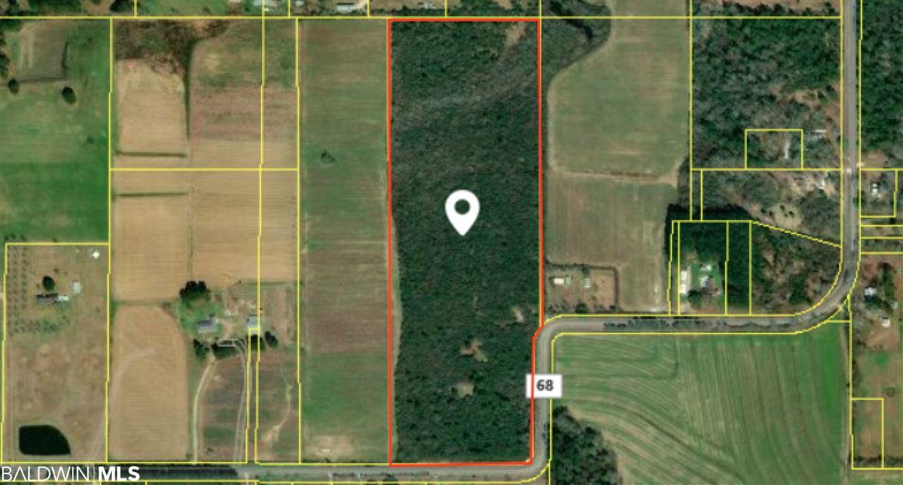 his 30 acre tract is located on County Road 68 less than 2 miles from the I-10 Beach Express exit. This property is flat and would be absolutely perfect for a custom home or weekend retreat. Utilities are available on CR-68 which would make developing it simple. Property has over half a mile of paved road frontage so dividing it for development would be very easy. These properties are very hard to find and with this one you're less than 30 minutes from Mobile and only about 40 minutes away from the beach!