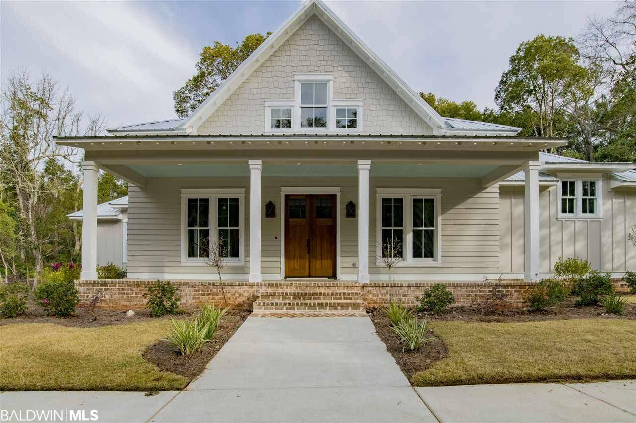 Beautiful custom Coastal Cottage home by Baker Clark Homes. Built just two blocks from the bay on some of the last lots in Old Daphne, this gorgeous 4/3.5 with nearly 3000 sf has it all!  So much thoughtful detail has been designed into this home, and you will see and feel it from the moment you walk through the front entry.  From the wood beams, to the shiplap walls, wood clad windows, phenomenal kitchen with commercial grade appliances and mirrored subway backsplash - and this is just to name a few!  The spacious downstairs owner's retreat features a divine master bath with oversized soaker tub and separate shower.   And as an extension of the living room,  the outdoor cook center and  fireplace with fenced yard makes this home perfect for entertaining and spending quality time with the family!  Please call for a full list of amenities and to schedule Headyour private showing today! Gold Fortified Construction