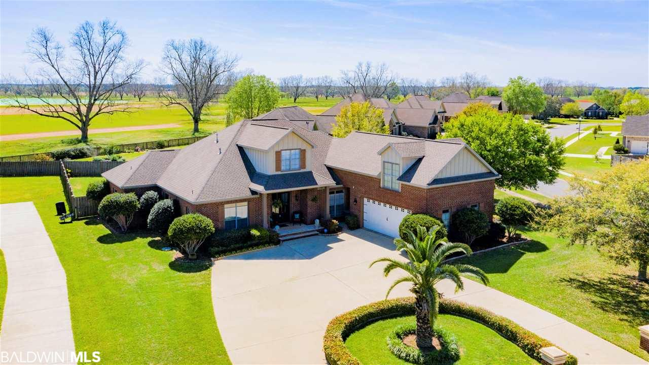 This large, one-owner, custom home built by Ray Lambert, sits on an over ½ acre corner lot, and is loaded with top of the line amenities and distinctive touches including: wide plank brushed oak floors, built-in bookcases, architectural columns, heavy moldings, wainscoting, turtle back ceilings and transom windows. Walking through the double mahogany front doors, you step into the foyer with soaring 20' ceilings and an open living and dining room. With built-in speakers, component closet for your receiver and cable boxes and a wet bar with sink, this home is designed with the entertainer in mind. The step-up area off the living room is currently set up as a bar area but would also make a perfect office or family homework area with the gorgeous arched wood bookcases that reach from floor to ceiling. The bright sunroom off the living room is almost 350 sq ft, is heated and cooled and has a wall of windows that can be opened to screen. The large chef's kitchen is centered around the sizable center island and features granite counter tops, travertine back splash and GE profile stainless steel appliances. The split-floor plan, has the master on the other side of the house and the master bath has separate vanities, walk-in closets, shower and jetted tub. Upstairs can be used as a theatre/bonus room, mother-in-law or teen suite with its own full bath. Each of the 4 bedrooms in the home has a connected full bathroom. Outside, off the sunroom, the newly decked back porch overlooks the private, fenced, back yard and backs up to the Corte farm. The home features an irrigation system and is wired for a whole house generator. Bellaton's community pool offers a huge deck area for relaxing and sunning as well as a zero entry. The pool area also has a community gas grill, outdoor shower, and cabana area. Neighborhood also has stocked lakes and the Picalo house that can be used for neighborhood events. SELLERS ARE MOTIVATED, BRING OFFERS.