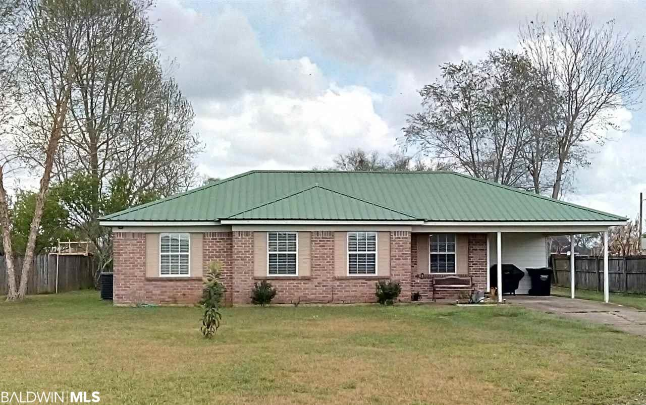 Looking for a place to call home and a place that will wow you with convenience to I-10, Highways 59 and 90. Just moments away from schools and a small country feel downtown. Near by stores, restaurants and medical offices are just a drive away. This may be the ideal home that you are looking to start your first home ownership venture, retirement home or a home to invest in for potential rental opportunities. This home offers unlimited possibilities.  New HVAC (1 month old); metal roof, new hot water heater. Upgraded flooring, remodeled kitchen with new cabinets, new counter top and brightly painted home throughout.  Enjoy your outside 22 x 12 workshop or turn into your outdoor activity building.  Very unique; with built-in work bench. Your backyard yard is adorned with mature fruit trees; that includes, peach and fig; plenty to can or just enjoy eating fresh off the tree. This house qualifies for a USDA Loan.  Seller's disclosure documents available.  Built by Benchmark. . . Don't let this one slip by. Schedule your tour today!