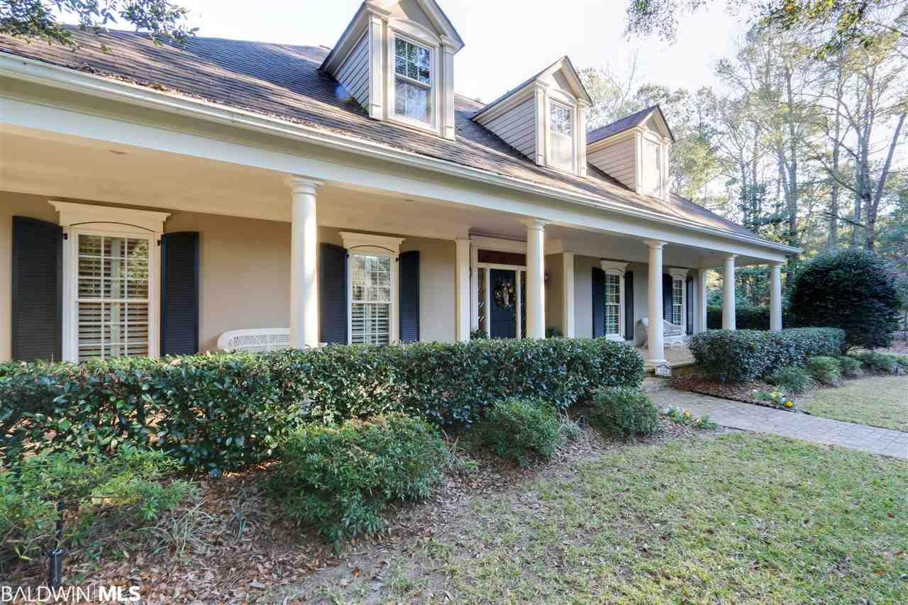Welcome inside this beautiful custom built home in the heart of Olde Daphne on stately Captain O'Neal Drive.  This well built home sits on a large established landscaped corner lot with circular drive. It is one of a select few homes on the street that has deeded bay access with private pier and sandy Beach.The beautiful mature back yard has a heated pool/heated hot tub with pool house (could be a perfect guest house or mother in law suite). The interior offers an easy open floor plan with pine hardwood floors, vaulted ceilings and bright cheerful sunroom over looking the beautiful back yard. Other features and upgrades in this home are the split brick floors in the entry way, custom cabinetry, stainless steel GE appliances, Pella windows, 3 new HVAC units, 3 new hot water heaters, new well pump, pool pump, pool heater. The interior was completely repainted at purchase and ship lapped added to 1/2 bath walls along with new hardwood flooring upstairs. The location is defiantly one of the perks of this home which is walking distance or a fun golf cart ride away from the public boat launch, children's park, Bayside Academy, Christ the King, Daphne public schools and all the shops and restaurants of Olde Towne Daphne. A true must see with so much to offer for the price. House -1 story 2576 sq ft + 2nd floor 980 sq ft = 3556 sq ft; Pool House - 18.25 x 30.25 = 551 sq ft; 2 Car Garage - 24.25 x 24.25 = 590 sq ft.