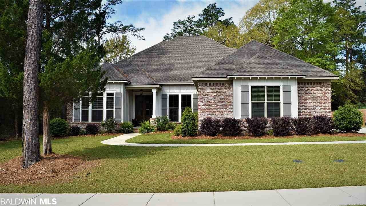 """Oak Creek subdivision just off of Hwy 90 located between Home Depot and Lowes! A rare find and extremely convenient to everything! This like new built in 2017 Truland Chelsea plan with 6 Bedrooms 4 full Baths is awesome from the moment you walk up to the beautiful stained wood double front doors. This is the Estate Series that comes with loads of crown molding, trim and 8 foot interior doors throughout. Once inside, you are welcomed by beautiful hand scraped hardwood floors in the foyer and dining room that extend through to the living area and Master Bedroom. Large living area includes a gas log fireplace with brick surround and custom wood mantle. Open to the breakfast area, formal dining and kitchen, this room is perfect for entertaining. From here you can go out and enjoy the covered/screened in back porch with deck and beautiful wooded backyard that is already fenced. The fabulous kitchen with many upgrades that include painted cabinets galore, upgraded granite countertops, large ceramic tile flooring, and top of the line Kitchenaid stainless-steel appliances, including a 36 inch five burner gas cooktop. There is also a large walk-in pantry and a huge center island and a breakfast bar. There is a mud room with bench area and the laundry room with extra storage and a deep laundry tub are both nearby. The main floor master bedroom is a great size and has a gorgeous trey ceiling, hand scraped wood floors and an awesome master bath. The bath is so spacious with tile flooring, separate jetted tub and custom shower, his & her vanities and his & her walk-in closet. There are 3 additional bedrooms on the main level, with the remaining bedrooms upstairs including a 5th & 6th bedroom that be used as a bonus room, extra living area or media room. Additional perks include Gold fortification for insurance savings, ridge vents, energy efficient appliances and two separate HVAC and two hot water heaters, irrigation & more. """"Owner is License Realtor in the State of AL"""""""