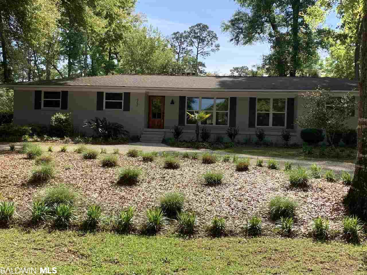 Location! Location!  This cute Cottage sits on two lots across from Mobile Bay w/bay access.  Brick, 4 bdrms, 2 baths, wonderful Florida room across the back, two car attached garage w/fenced back yard.Close to town and beaches. Many upgrades including new front door.