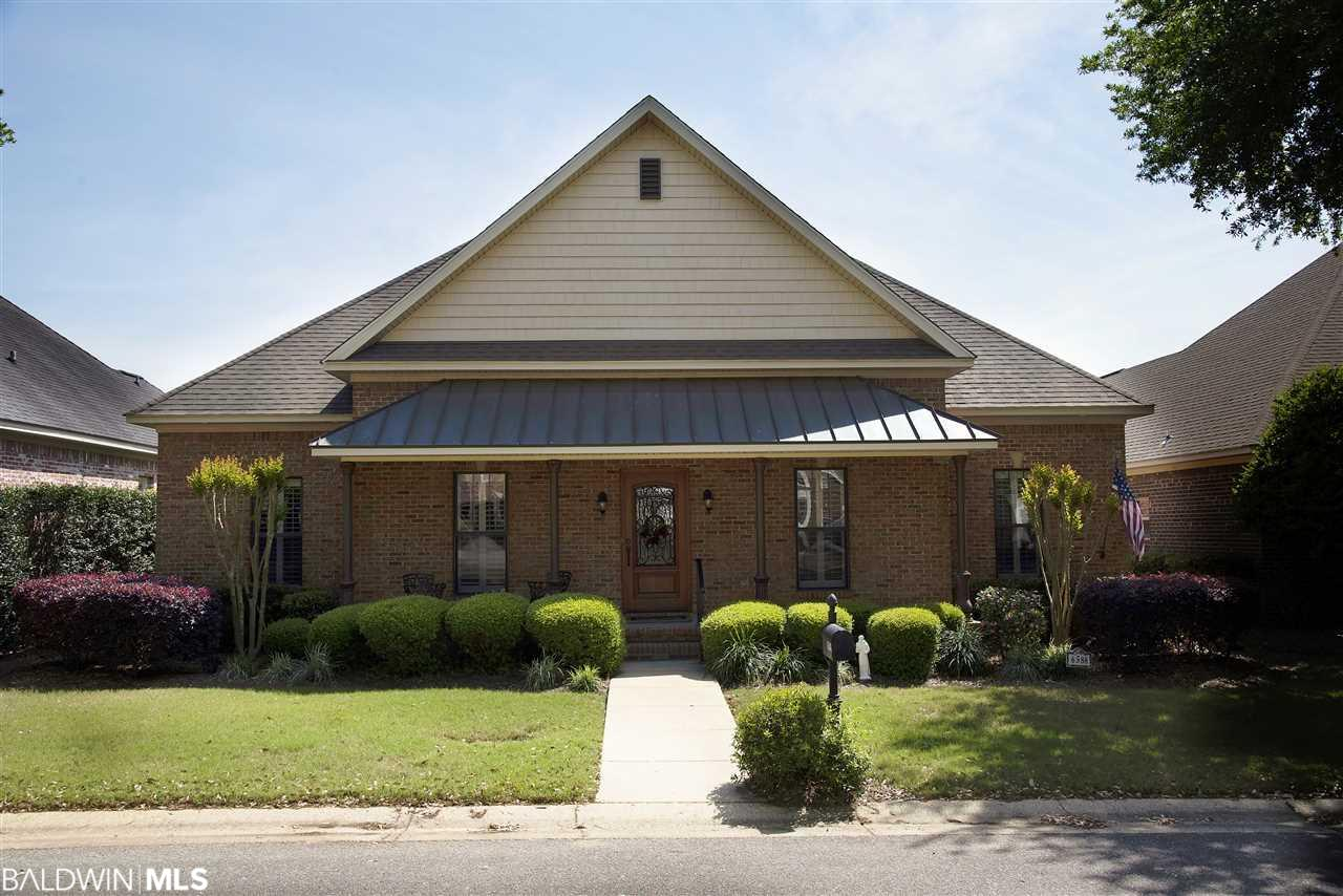 Wonderful Brick Patio Home in Point Clear Stables. Copper roof over front porch area. Plantation Shutters through-out home. Open Floor plan; Hardwood through-out downstairs. Bonus Room up with carpet. Kitchen has granite with island that holds gas range with a beautiful metal vent hood. Built-in shelves for cookbooks. Living, Breakfast, & Kitchen are all open area. Gas logs in fireplace with built-ins on both sides. Great back porch that connects to deck overlooking beautiful backyard. 2 HVAC units. Central Vacuum .Separate meter for lawn. Great Pond with fountain and common area.  LISTING BROKER MAKES NO REPRESENTATION TO SQUARE FOOTAGE ACCURACY. BUYER TO VERIFY.