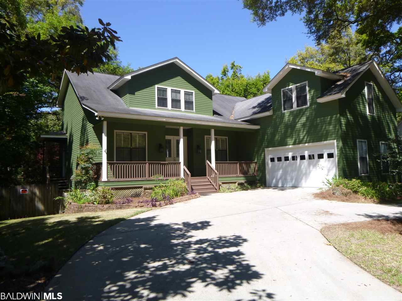 WOW!!!!!!! BIG REDUCTION ON A GREAT HOUSE. ***Welcome to the amazing Green House just one block from Downtown Fairhope.  Three levels of large rooms with four and one-half baths, laundry room on main level and one on the second floor.  Wonderful screened porch on the main level...perfect for entertaining and another one on the lower level that opens out to a landscaped backyard with fruit trees and lots of plants.  Home has lots of amenities...SEE LIST AND LAYOUT OF ALL THREE FLOORS IN MLS DOCUMENTS.