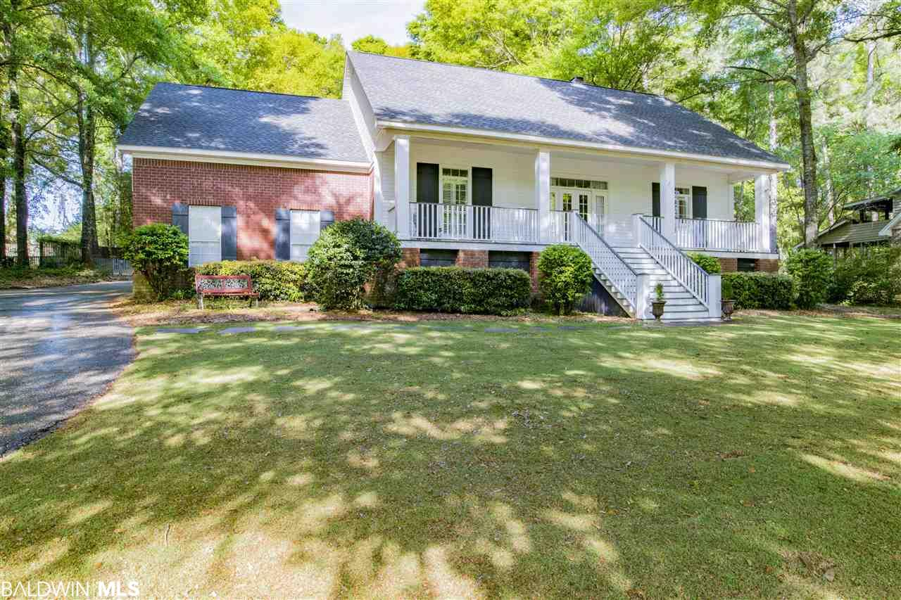 Lovely, Creole home on a large, beautifully landscaped lot in the Montrose Woods neighborhood of Fairhope. This 4 bedroom, 3 bath home has been freshly painted with modern, neutral tones and features some new carpet as well. Custom details throughout, the home features a split-bedroom floorplan, a cozy great room, stylish master and dining room, and large kitchen with a breakfast area and plenty of counter and cabinet space. The 4th bedroom, with full bath, could also be used as a bonus room. There is abundant outdoor possibilities with a covered porch, boardwalks, pergola and swing, large deck, gazebo and raised platform among mature trees within a fenced yard. This gorgeous home is conveniently located in a quiet neighborhood in the Fairhope school zone, close to shopping, restaurants and recreation.