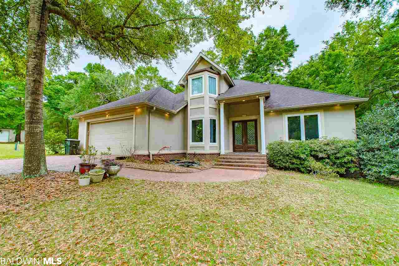 This is the perfect property for the family with an RV, a car collection, or in need of additional storage with tall ceilings.  This beautiful custom-built home is sitting on 3.06 acres of land in the heart of daphne with a 100-foot-wide warehouse with four 14-foot-tall roll up doors and plenty of space.  This warehouse also has a full 1 bedroom 1 bath apartment attached to the right side! Every door and window in the home is a European imported tilt and turn with a double sash, very elegant and unique to see!  Both interior A/C units were replaced two months ago.  If you are looking for storage space, acres of land, and the convenience of being within city limits and nearby to any eastern shore location; this home is for you!   All information provided is deemed reliable but not guaranteed. Buyer or buyer's agent to verify all information.