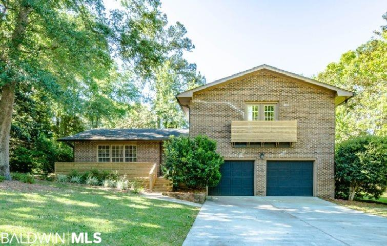 FAIRHOPE FAMILY LIVING AT ITS FINEST!  This well maintained, move-in ready all brick 4/2.5 home is located in highly desirable downtown Fairhope sitting on newly landscaped double lot and will not last long.  This home is move in ready featuring amazing hardwood floors, updated kitchen and baths, both living room and family room, eat-in kitchen, and separate dining room.  Easy outdoor living and plenty of play space to roam!  Walking distance to downtown restaurants, shopping, parades and festivals or explore the Bay and experience the beautiful sunsets!
