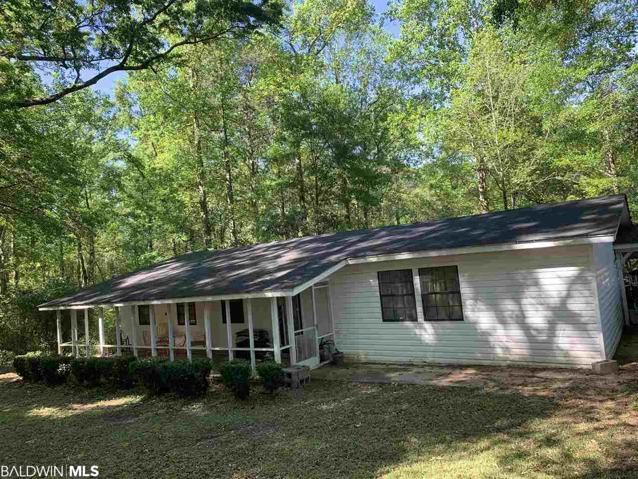 Lovely home in a quiet setting on 7 acres! If you're looking for tranquility and a home to put your own touches on, this home is for you! Roof has been replaced on the home within the last 2 yrs except over the car port. Home is being SOLD AS IS. Possible short sale