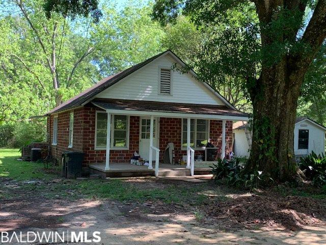 Turn the clock back to this early 1900's cutie!  Recently updated with new paint and new flooring inside. The home is located in a great location close to Summerdale Elementary.  There is a 12 X 26  outbuilding. The lot has Beautiful mature trees!