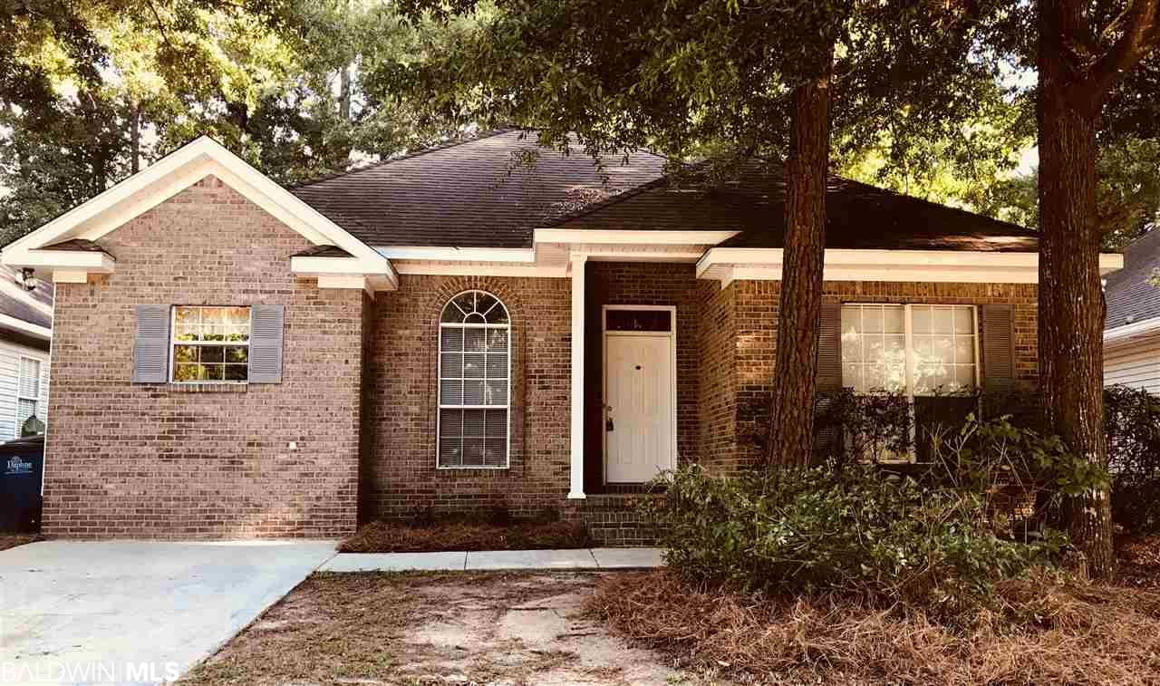 This beautiful 3 bedroom / 2 bath is located in the heart of Daphne, close to schools, shopping, restaurants and parks.  This home has been freshly painted, new carpet installed in all 3 bedrooms with tile and laminate flooring throughout.  Spacious open plan with the den opening to the kitchen / dining area - perfect for entertaining.  Gas fireplace in the den offers a cozy area that also includes Tray ceilings.  Split floor plan allows for master bedroom privacy in this very large room.  Master room opens up to master bath having double vanities, jetted garden tub, separate shower, his and her master closets with lots of space.  The backyard is fully fenced with a covered porch for outside enjoyment.  Pex plumbing replaced with a new system in 2016.  New AC unit put in 2013 - compliant with R410 coolant regulations.  Vacant and ready for you to move in!
