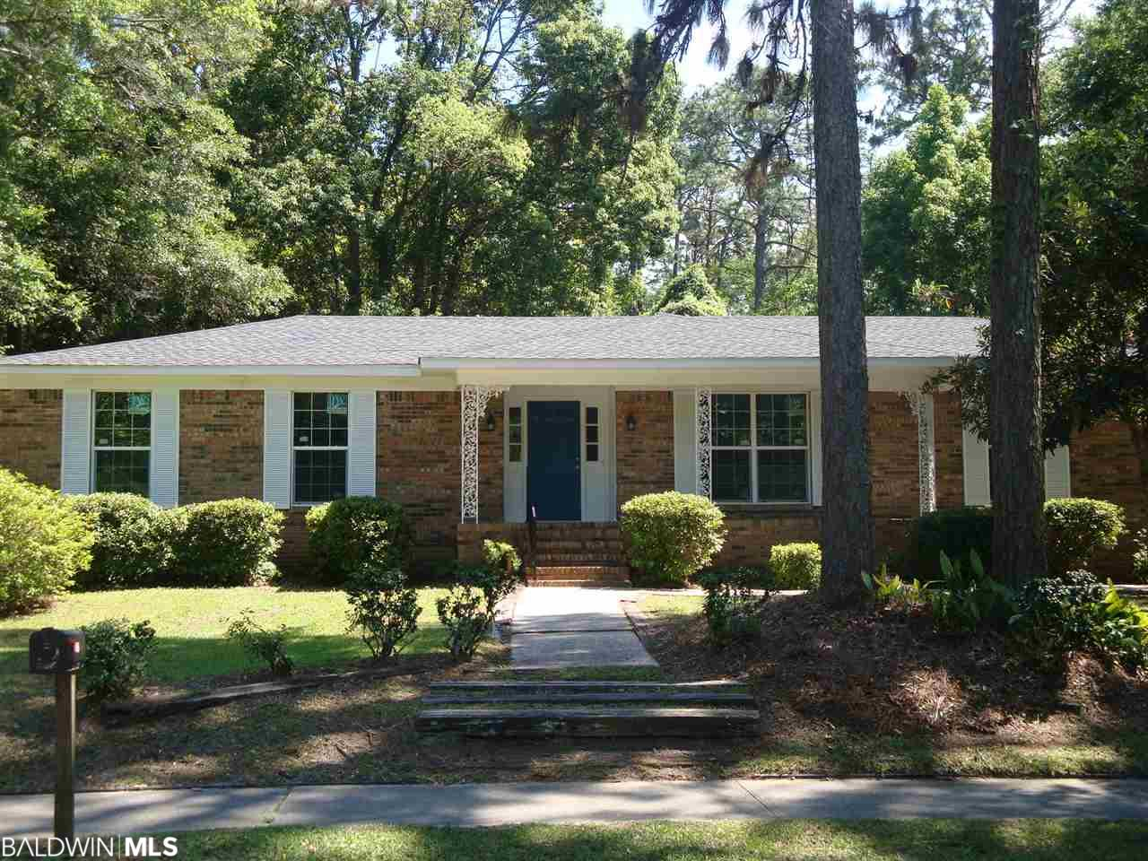 Completely renovated, spacious brick home in the heart of Fairhope. High quality waterproof laminate throughout the entire house. Freshly painted. Updated bathrooms and kitchen. Eight walk-in closets. New hurricane proof windows throughout the house. Faces Gayfer Ave with driveway on Blue Island. Two door enclosed and attached garage. Front porch; large patio in fenced-in backyard. New Timberline roof put on in 2018.  LISTING BROKER MAKES NO REPRESENTATION TO SQUARE FOOTAGE ACCURACY. BUYER TO VERIFY.