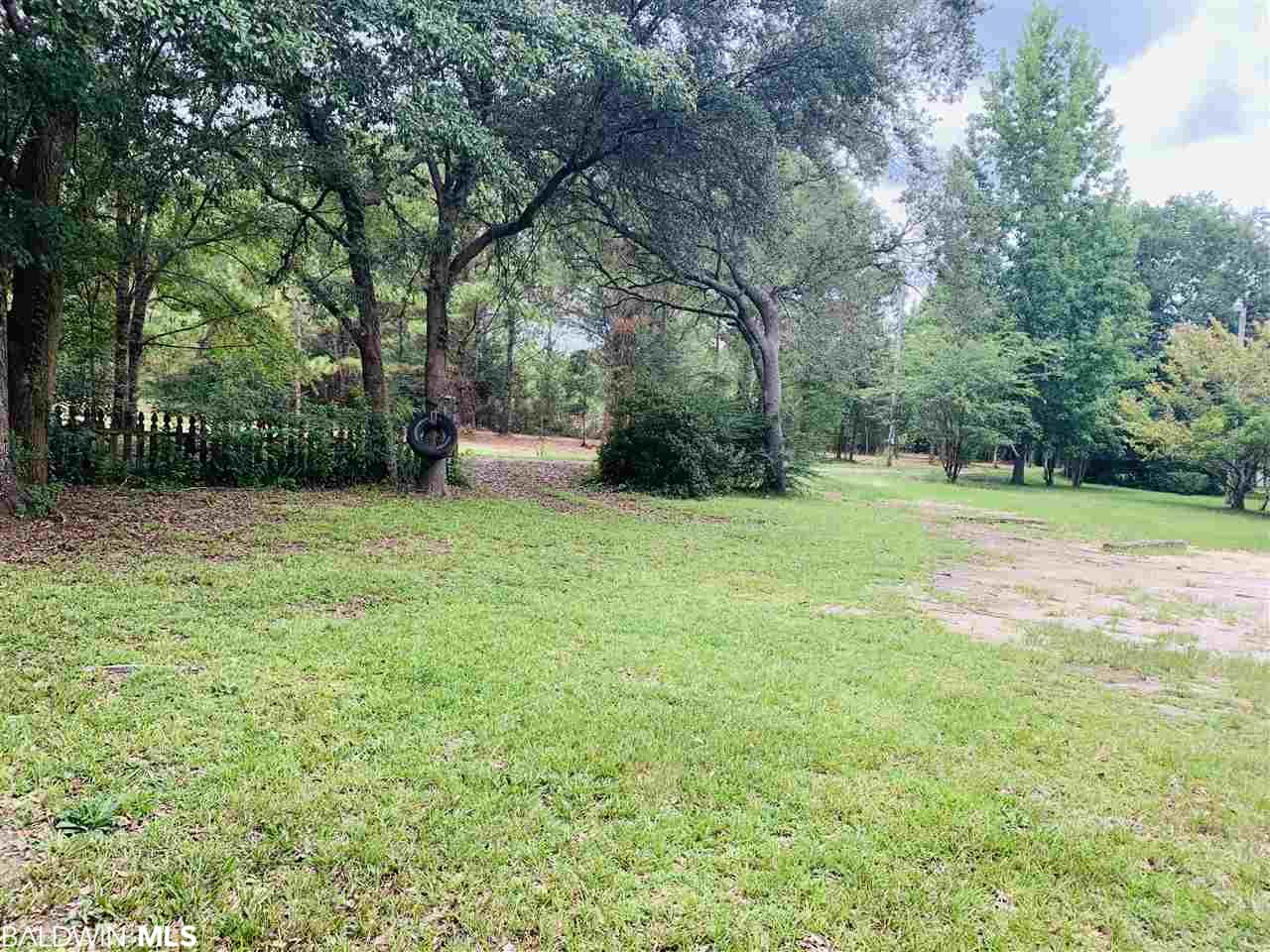 This beautiful 3 bedroom 2 bath home is located on half an acre in Fairhope.  Features include brand new flooring(2019), freshly painted interior, fireplace, updated smoothed ceilings throughout(2019), upgraded light fixtures and much more. The master bedroom has a large walk in closet and lots of windows. Property is one of kind in that it backs up to an open field providing a feeling of country living and across the street from Fish River.  Zoned for Fairhope schools. Schedule your showing today!