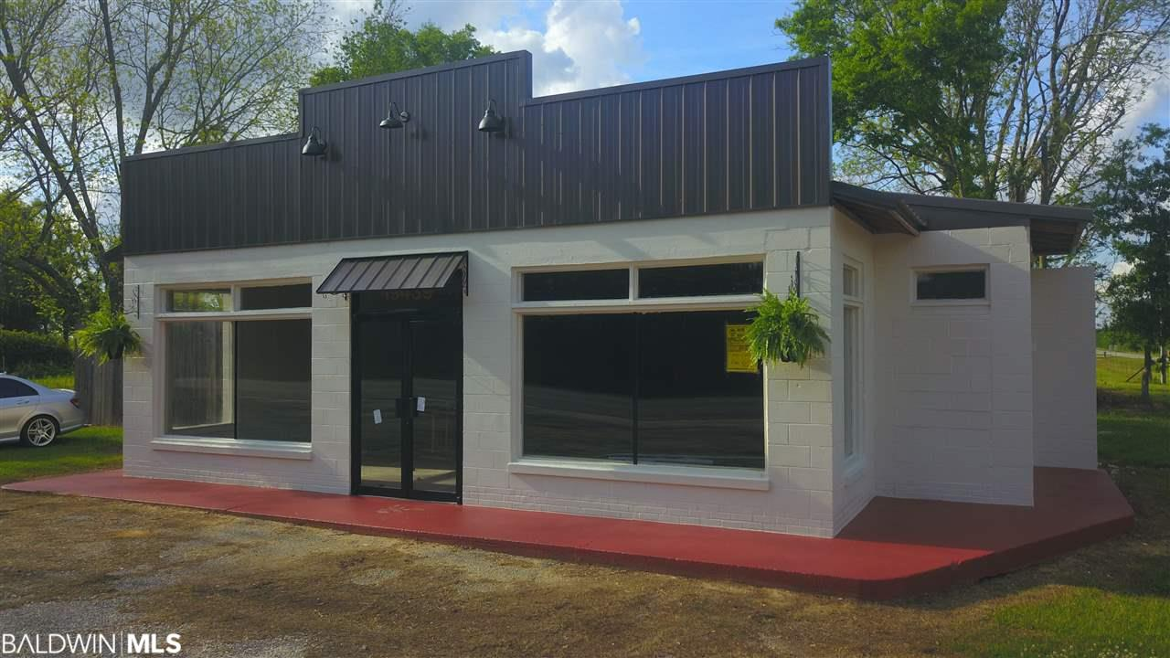 currently Zoned R-1.. This is a Primo location!  The UPPER crust of Robertsdale Al (Rossinton).  less than 1/2 mile to the Baldwin Beach Expressway... 3 miles from Buc-ee's , 1/2 mile from Coopers' lake, in Baldwin County Al.  This is a gem of a building.. Built in 1948, it has been everything from a Gas station to a restaurant.  Truly a hometown location in an uptown spot.  This building sits on a corner, at a stop light across the street from Country Convenient store. Many Renovations.  Ready for you to finish to your specs.  Recent new metal roof,,,  No issues, no tanks..  Great location for anything.. Agent is owner.. lot size based on legal description is 117 x 230.  Road frontage on CR 64 and CR 71.  There is currently a 1 bed/1 full bath cottage that sits next to building on the West side behind privacy fence.  It was moved in, to serve as an office for the the building, when a restaurant was going in. Did not happen.  The cottage currently rents for $485.00 a month.  Month to month.   The property is priced with the residential cottage.  Please call owner agent with all questions.
