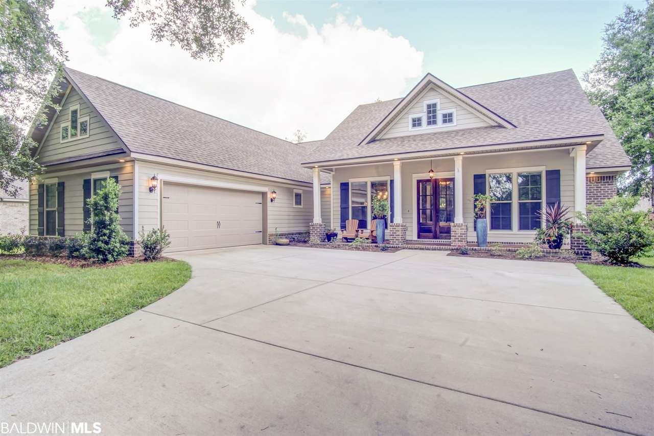 Situated just a few minutes from downtown Fairhope and in an excellent school district! This Thompson Hall home is in a tight knit neighborhood. Welcoming, friendly, neighbors bring a sense of home to this community. Stepping through the gorgeous glass double doors, enjoy open concept living. Take delight in hosting dinner parties or birthdays as the formal dining room provides space for all your friends and family. Never miss a minute of the fun with your kitchen overlooking the spacious living room. The beautiful shiplap wall placed perfectly behind the brick fireplace, paired with the stunning hardwood floor gives this home that warm cozy feeling. Custom white cabinetry, Granite countertops, and all stainless steel Kitchen Aid appliances make this kitchen one you will love sharing your recipes in. Bake a fresh batch of cookies while you talk to the children about their day at the eat-in kitchen table. Having the Madison floorplan by Truland means your master suite is all to itself. Soak up some peace and quiet in the comfort of your garden tub or with the breeze blowing through your windows. The two other large bedrooms provide so much room for your guests to enjoy. Pay attention to the details when walking out onto the screened in back porch. The stained concrete with the hardwood ceiling gives that true outdoors vibe. Grab your neighbors and have some fun in your completely fenced backyard. This remarkable home could be yours. Don't wait to make your appointment today.